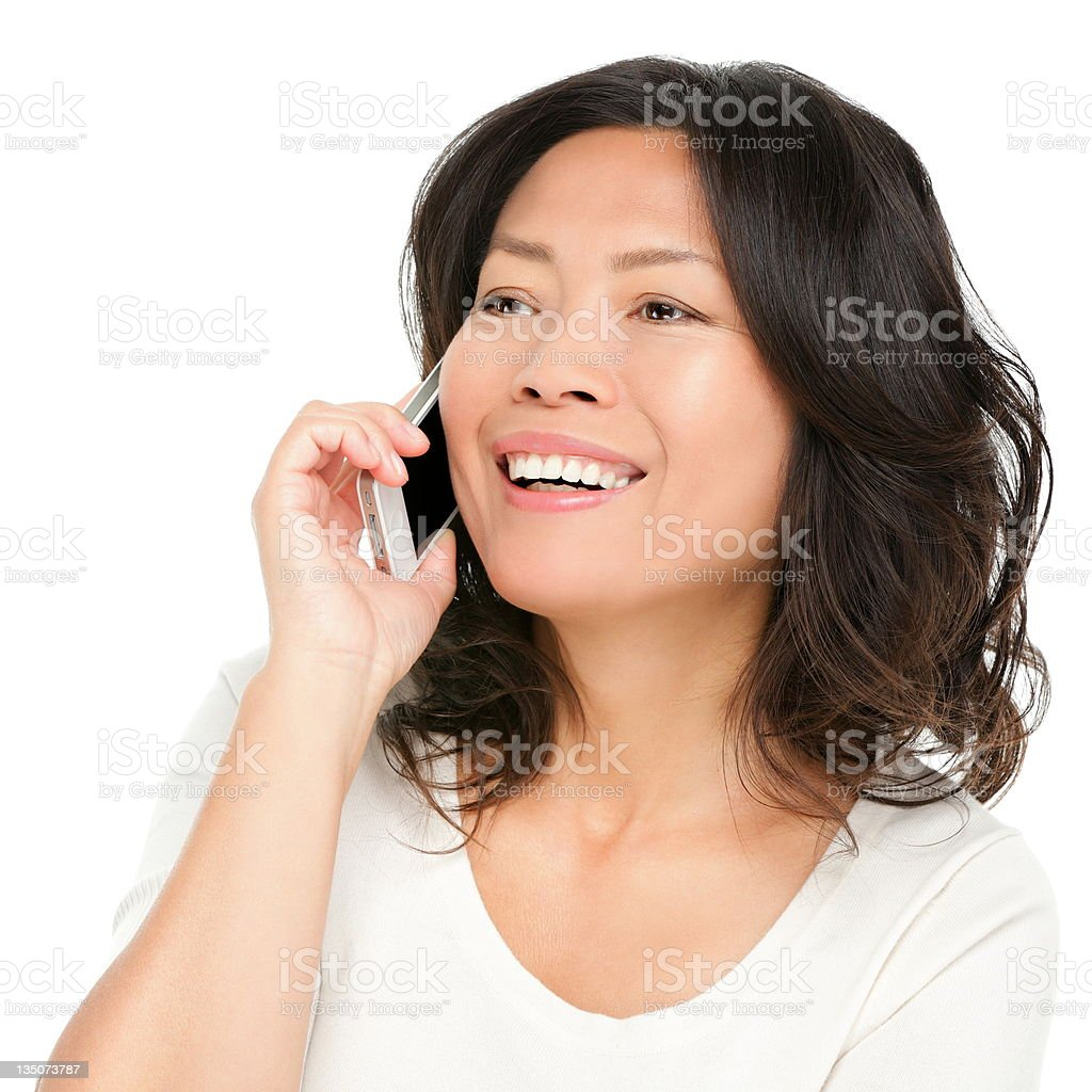 middle aged Asian woman on smartphone royalty-free stock photo