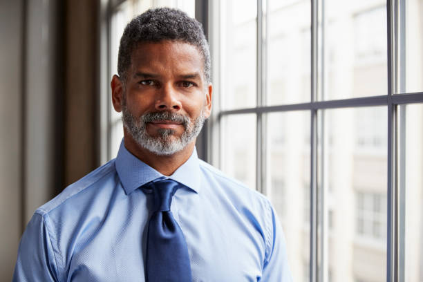 Middle aged black businessman looking to camera stock photo