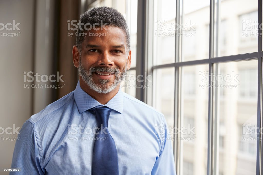 Middle aged black businessman smiling to camera stock photo