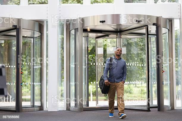Middle aged black man entering the foyer of modern building picture id597958686?b=1&k=6&m=597958686&s=612x612&h=9bitun50vss yuw3htlkinfm3jviekfdkpnn9uiyahu=