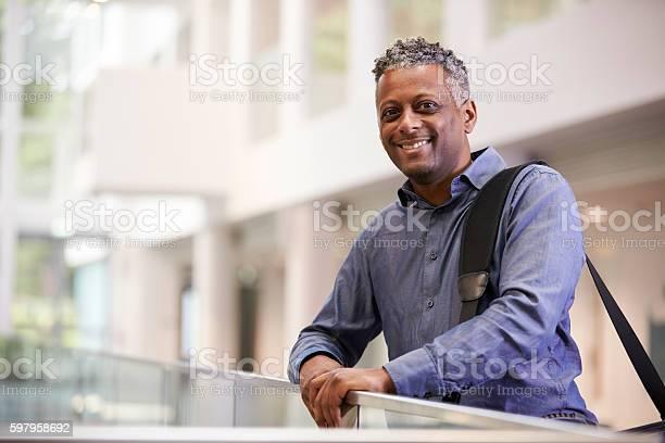 Middle aged black man smiling in modern building lobby picture id597958692?b=1&k=6&m=597958692&s=612x612&h=ljdyq2ivibqmrambnx8qqgf10magr7utzgvdjaylryq=