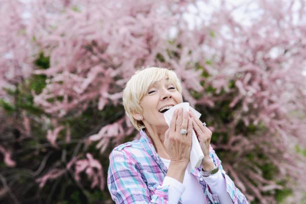 Middle aged blond woman sneezing seasonal allergy or cold picture id669684342?b=1&k=6&m=669684342&s=612x612&w=0&h=a5rgciaiodtgmogxq80bytqbekhvbvjlmjfy4svpjau=