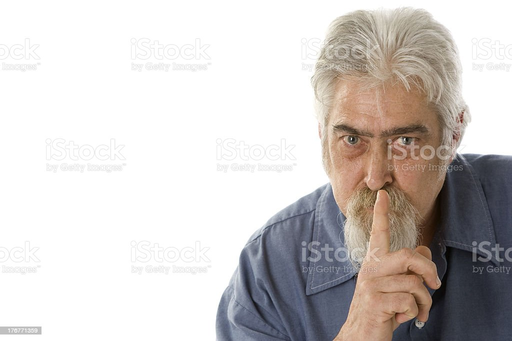 Middle Aged Blue Collar Worker with Beard Says Hush royalty-free stock photo