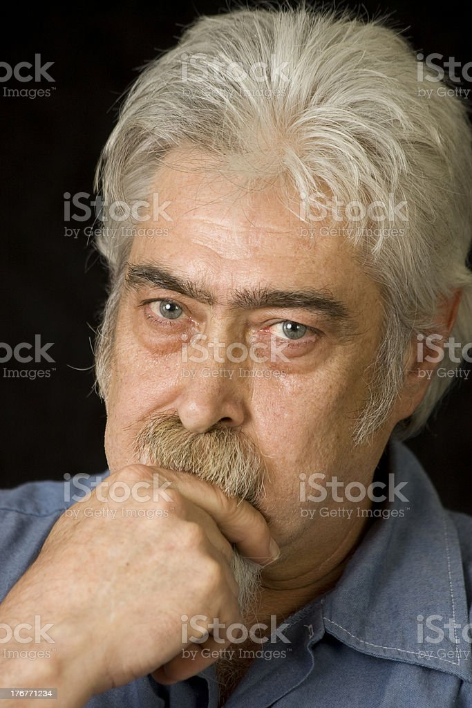 Middle Aged Blue Collar Worker with Serious Expression royalty-free stock photo