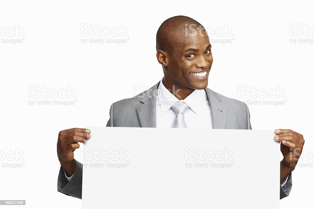 Middle aged business man holding a billboard against white background royalty-free stock photo