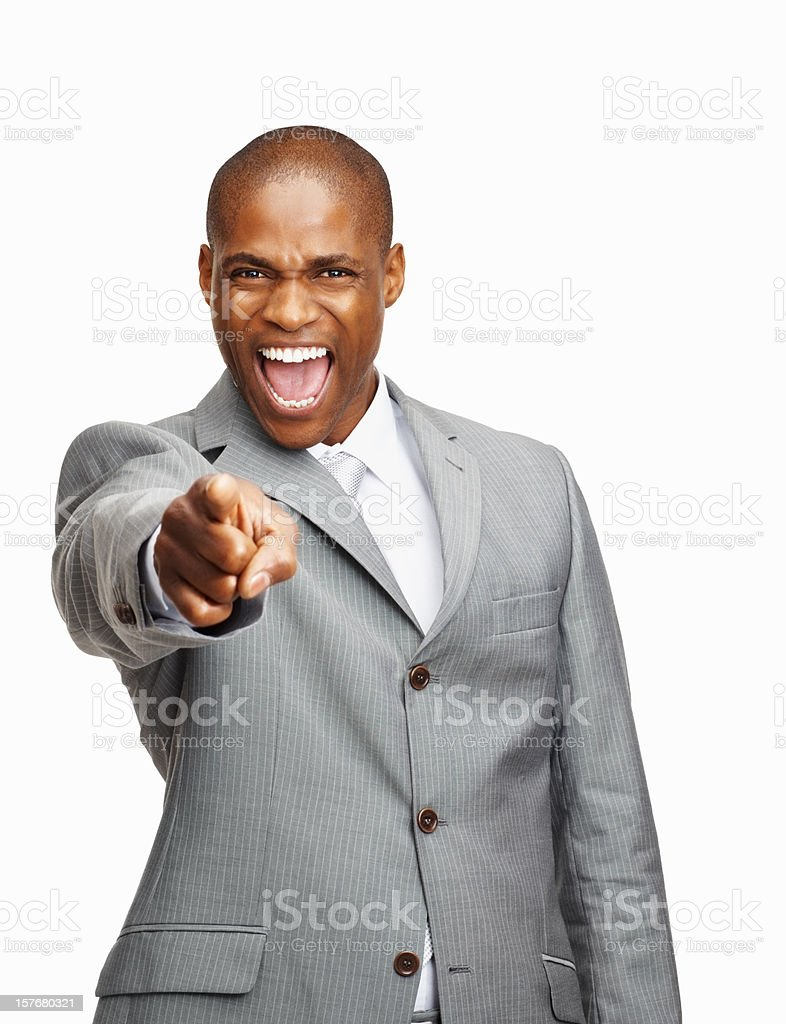 Middle aged business man screaming while pointing at you royalty-free stock photo