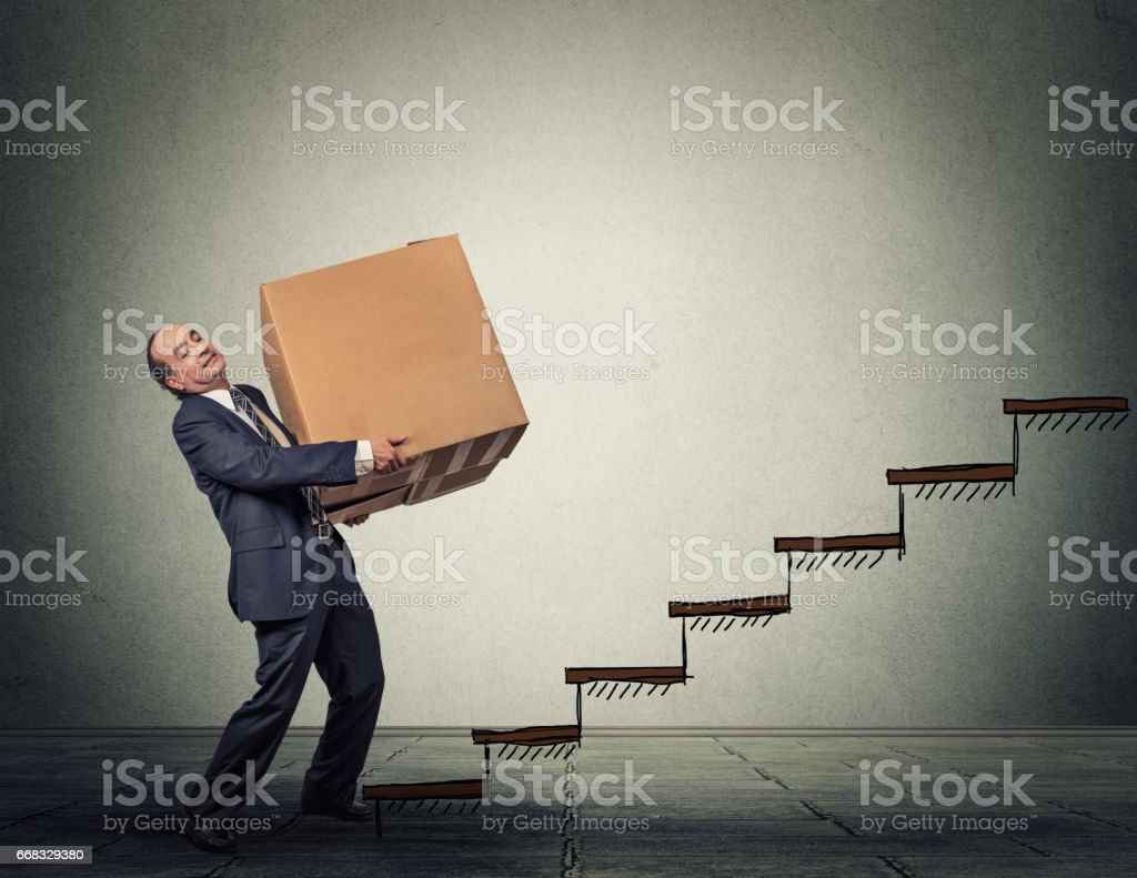 Middle aged business man with a difficult task stock photo