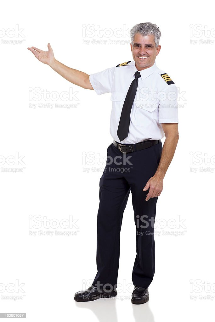 middle aged captain showing empty space stock photo