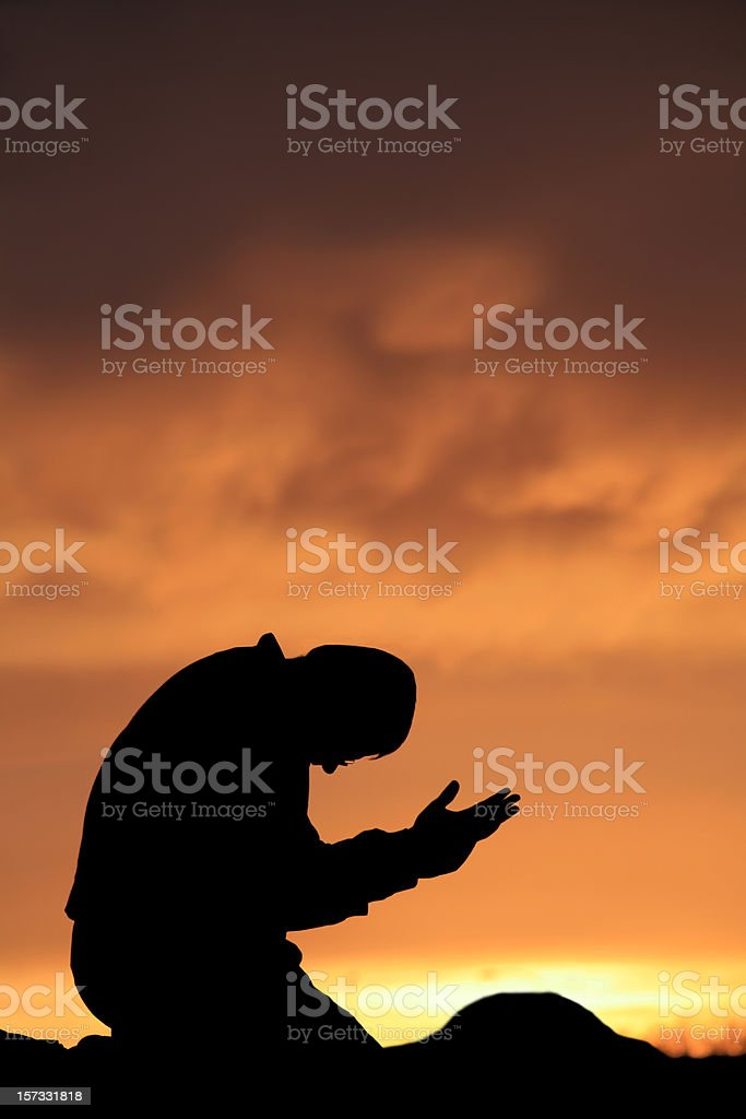 Middle Aged Caucasian Man Praying Outside royalty-free stock photo