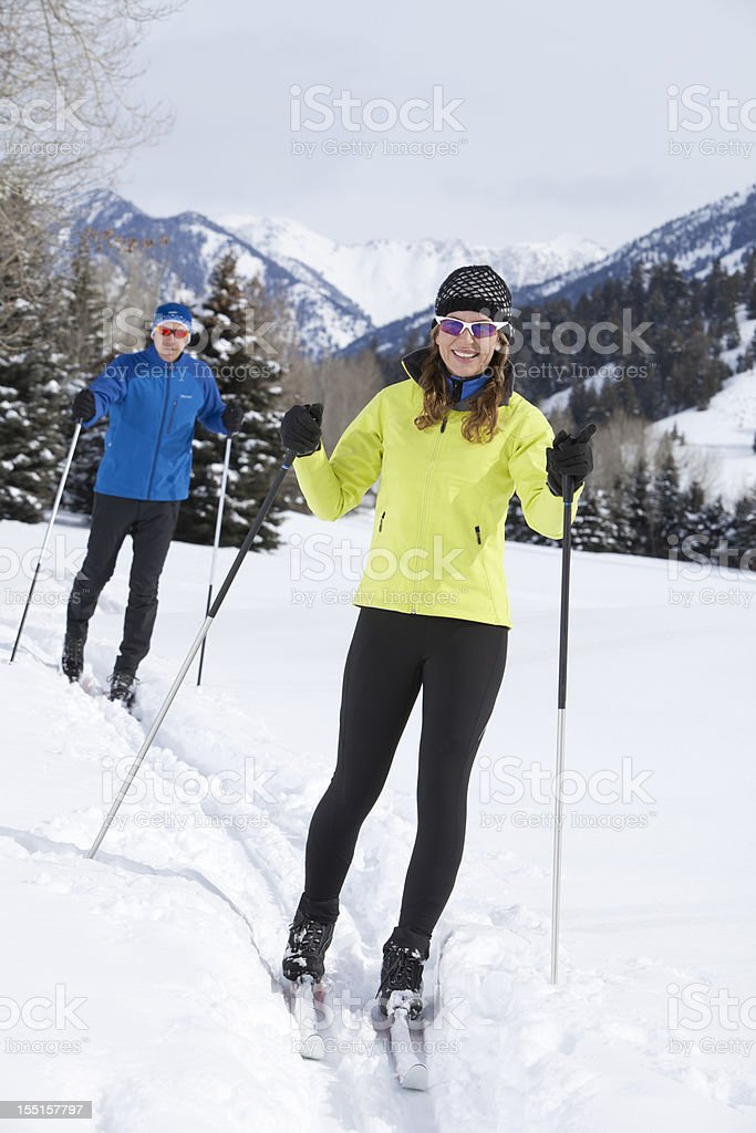 Middle Aged Couple Back Country Nordic Skiing stock photo