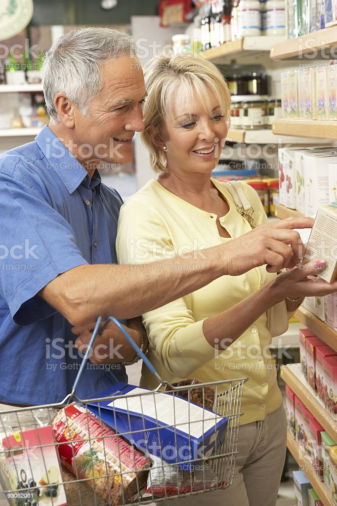 Middle aged couple buying herbal tea stock photo