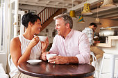 istock Middle aged couple in a cafe enjoying a coffee 473668940