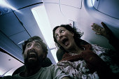 istock Middle aged couple in terror on a plane. 168614929