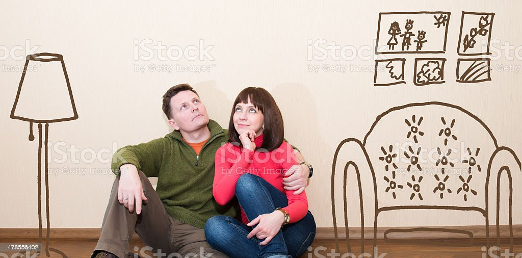 Middle aged couple in the new flat. stock photo
