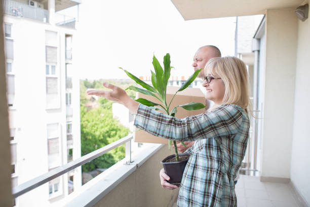 Middle aged couple moving into new apartment. stock photo