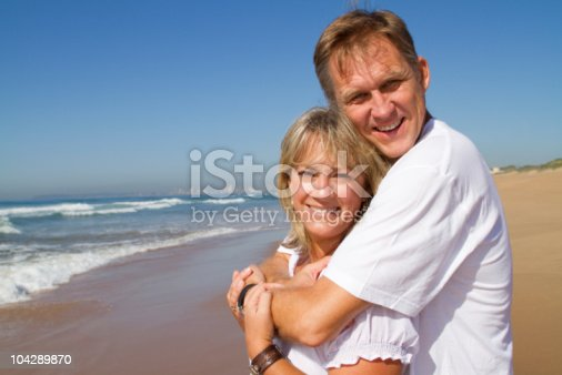 452783143 istock photo middle aged couple on beach 104289870