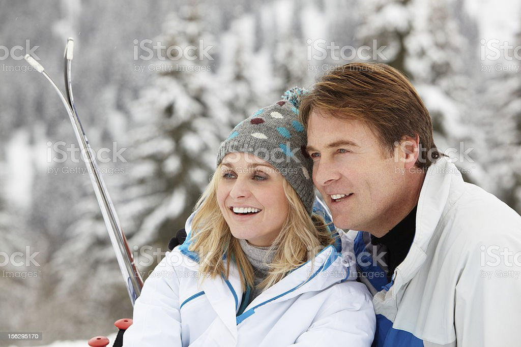 Middle Aged Couple On Ski Holiday In Mountains royalty-free stock photo