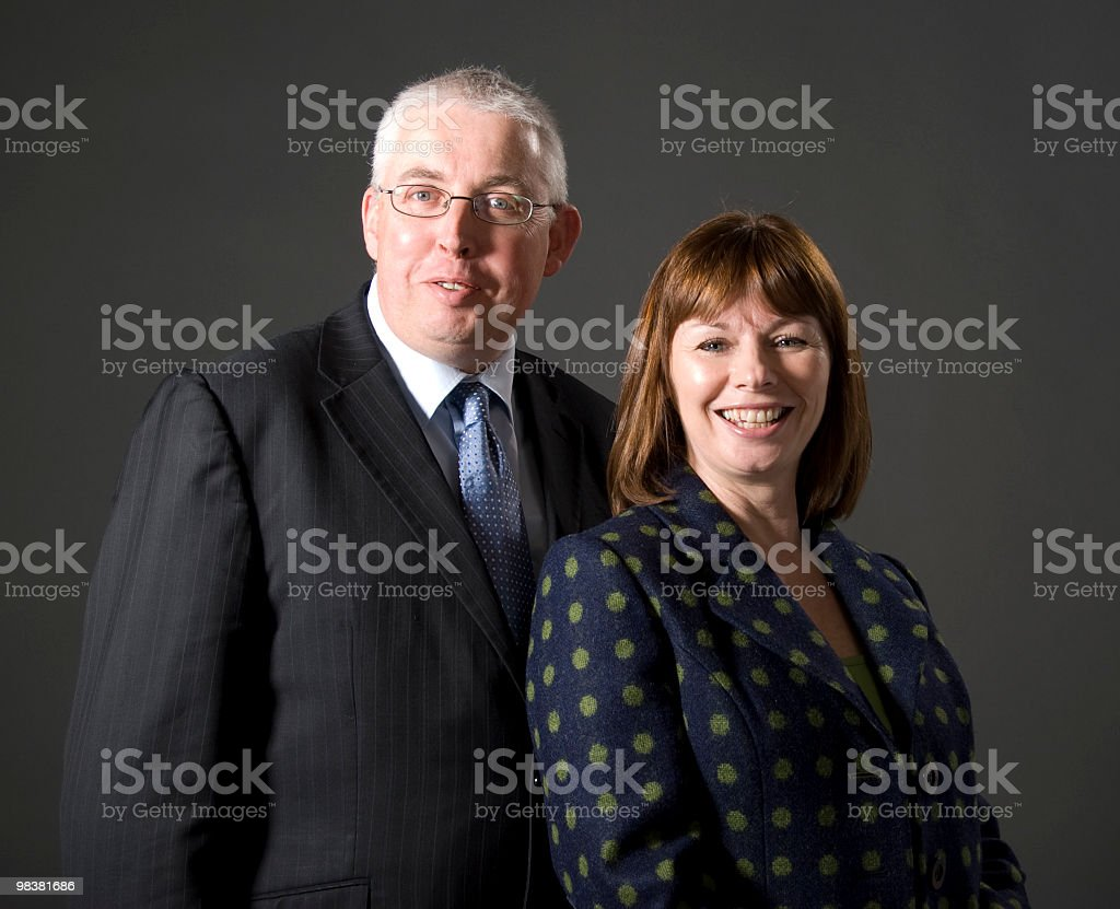 Middle Aged Couple Posing For Camera royalty-free stock photo