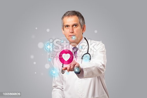 istock Middle aged doctor pressing modern medical type of button 1005866826
