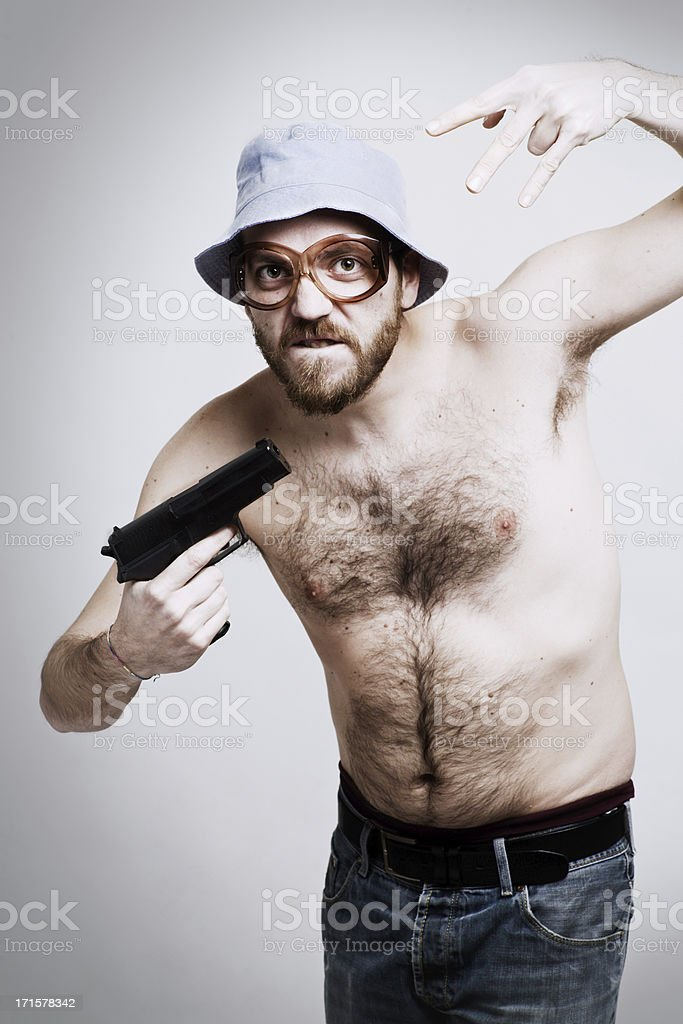 Middle aged extravagant man  gesturing holding a gun. stock photo