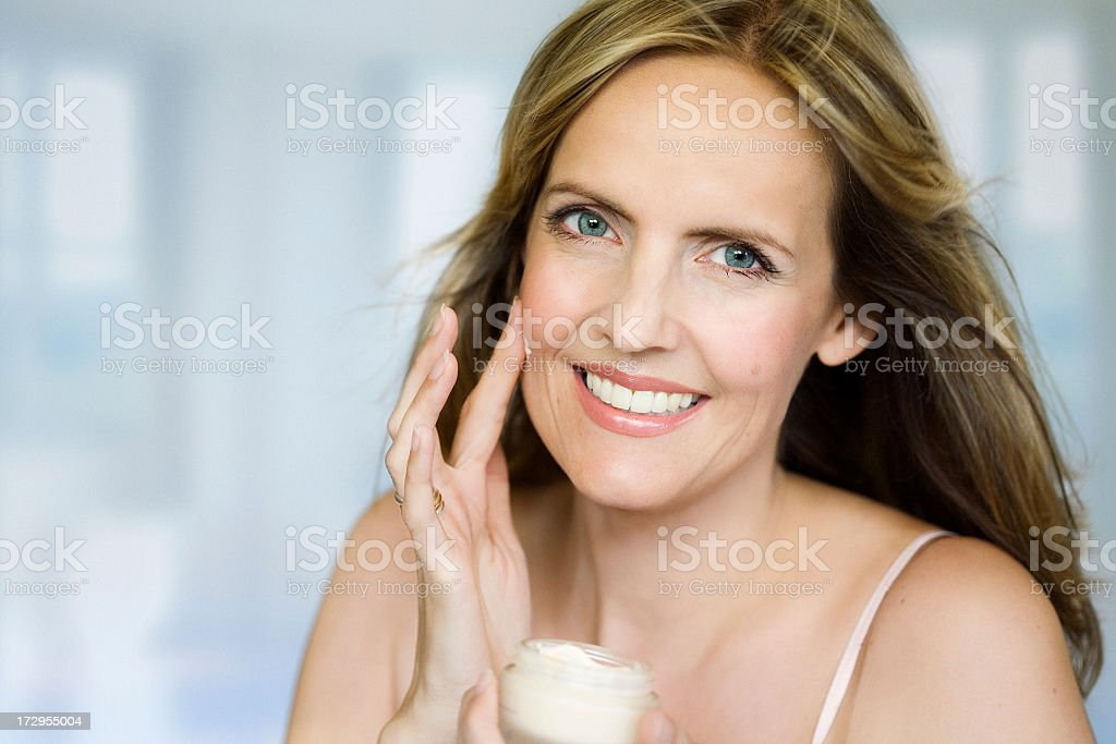 A middle aged female showing off her skin stock photo