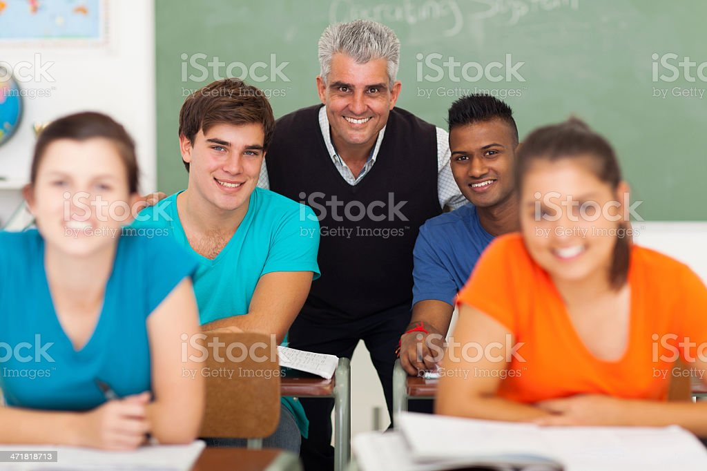 middle aged high school teacher with group of students stock photo