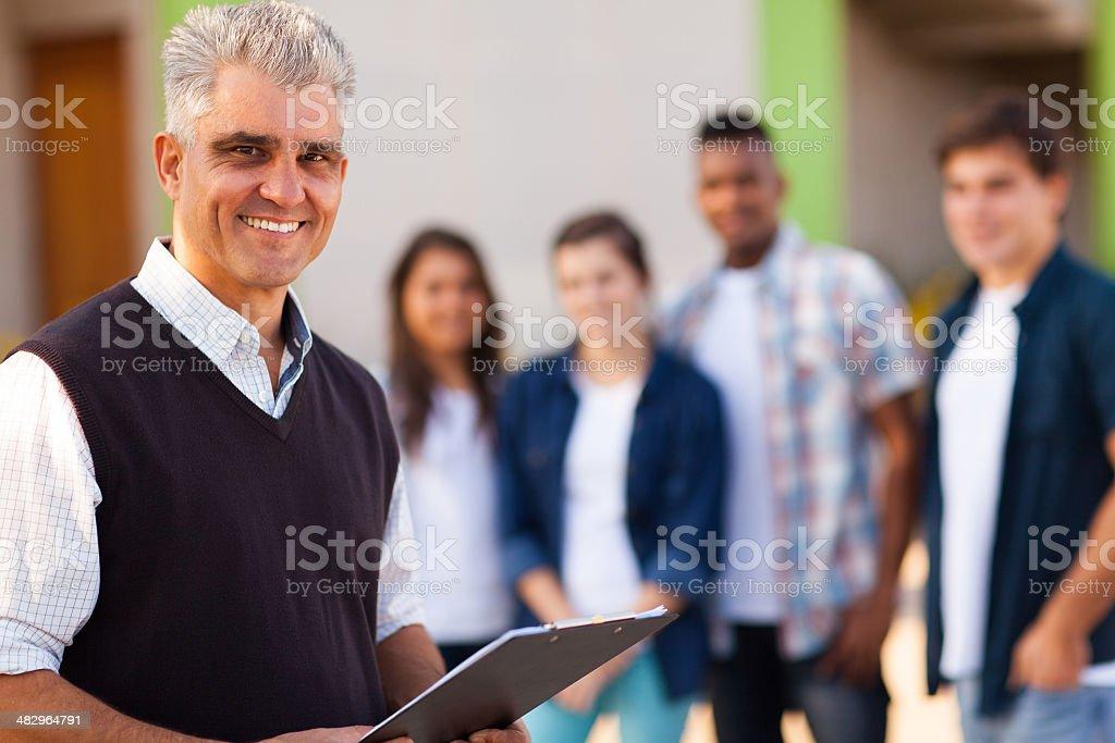 middle aged male high school teacher stock photo