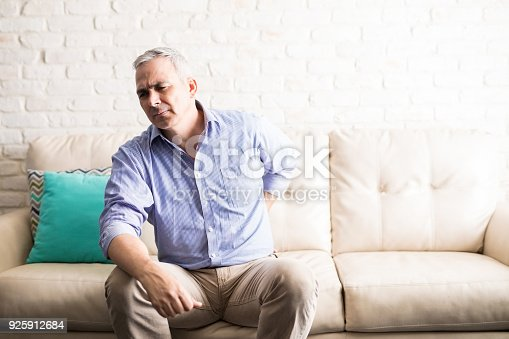 istock Middle aged man at home suffering from back pain 925912684