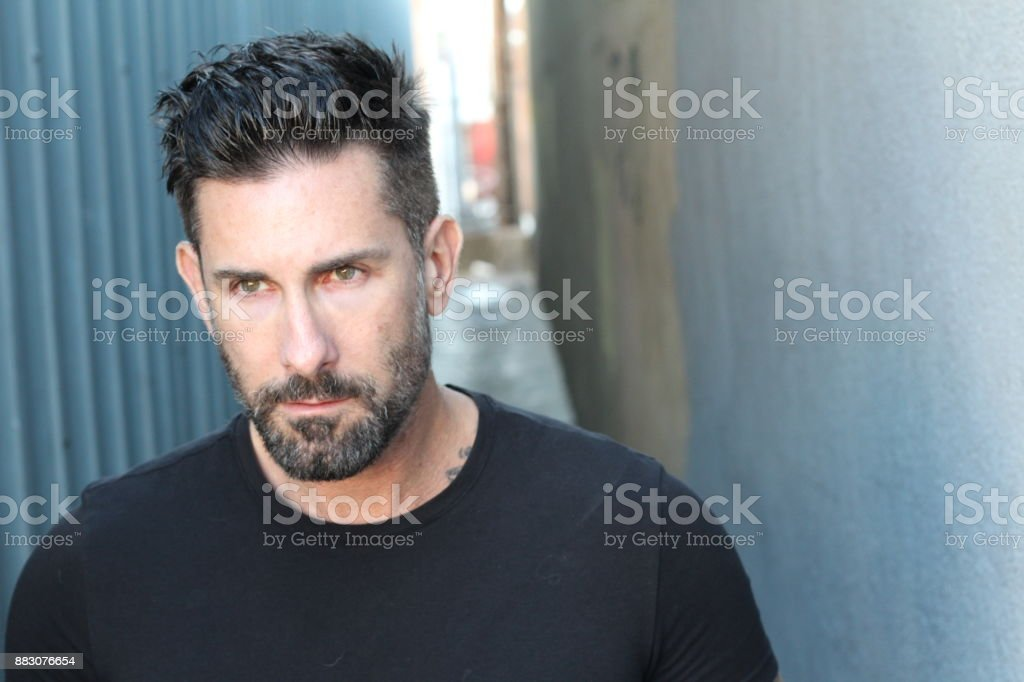 Middle aged man casually dressed looking away stock photo