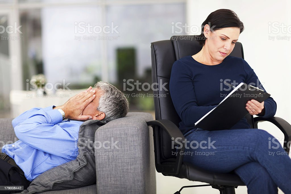 middle aged man crying during session with therapist royalty-free stock photo