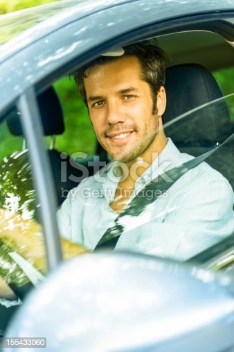 1051147634 istock photo Middle aged man driving a car 155433060