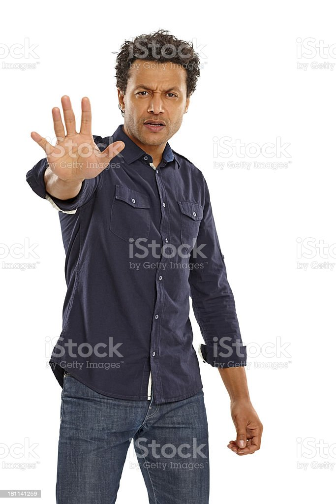Middle aged man gesturing stop sign over white royalty-free stock photo