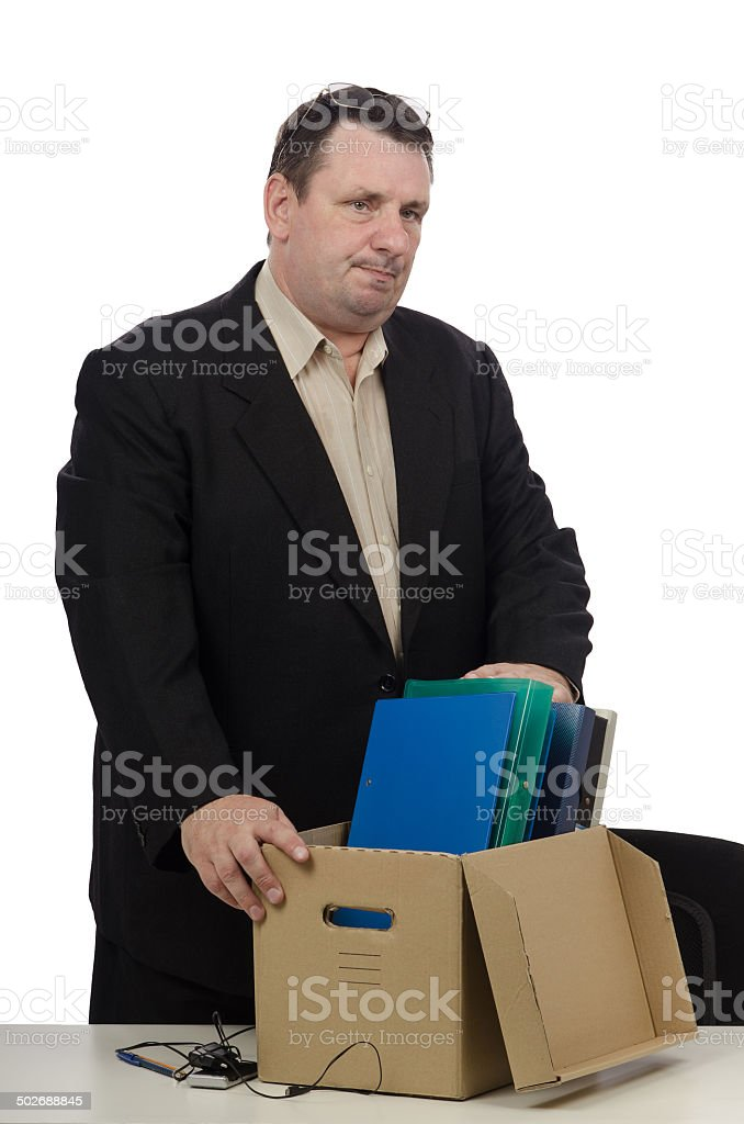 Middle aged man getting laid off stock photo