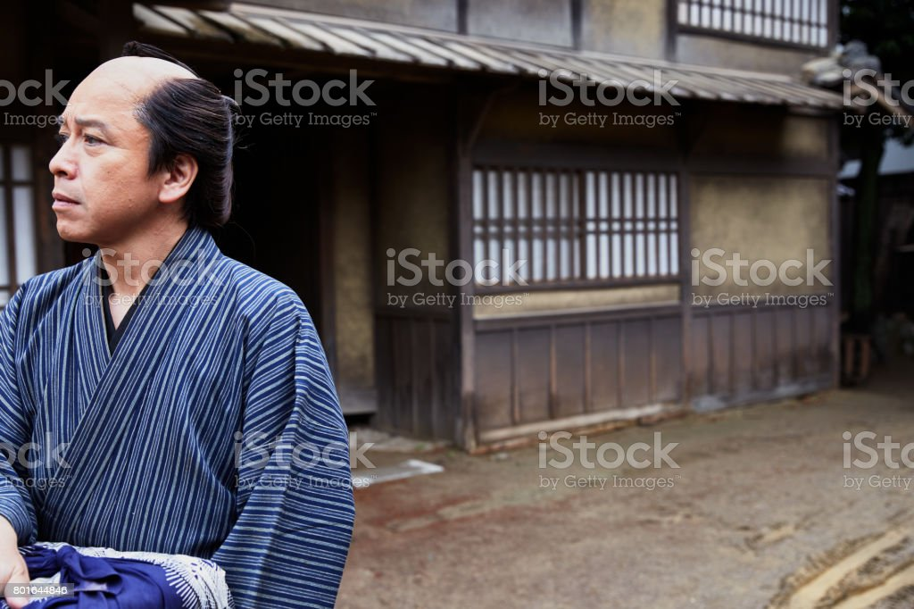 A middle aged man getting lost in the alleyway stock photo