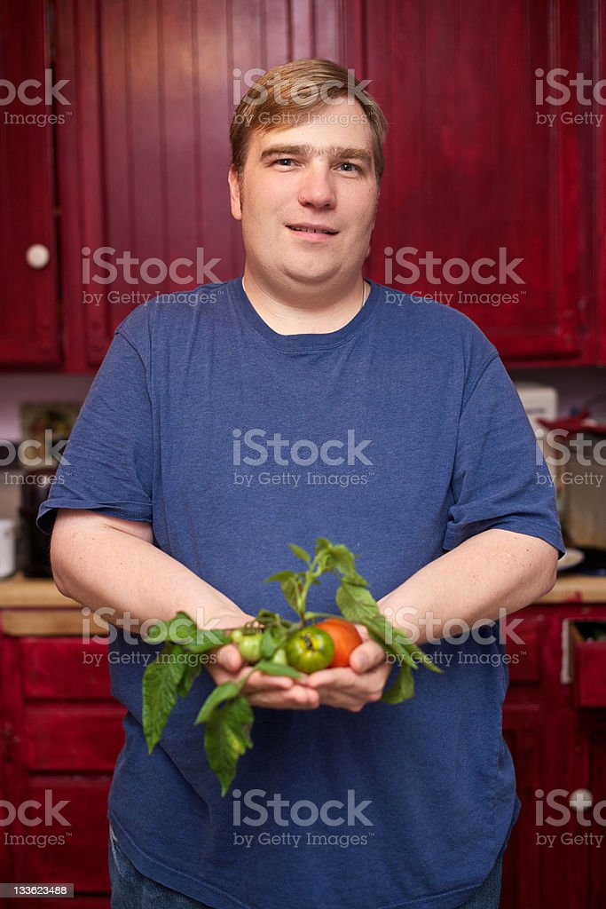 Middle Aged Man Holding an Assortment of Vegetables stock photo