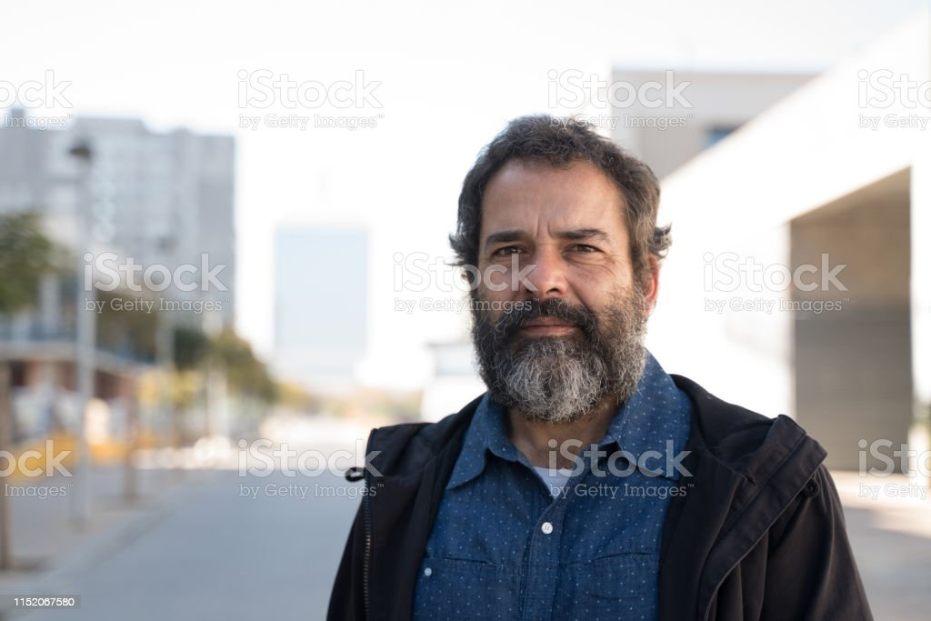 Middle aged man in a city street in winter.