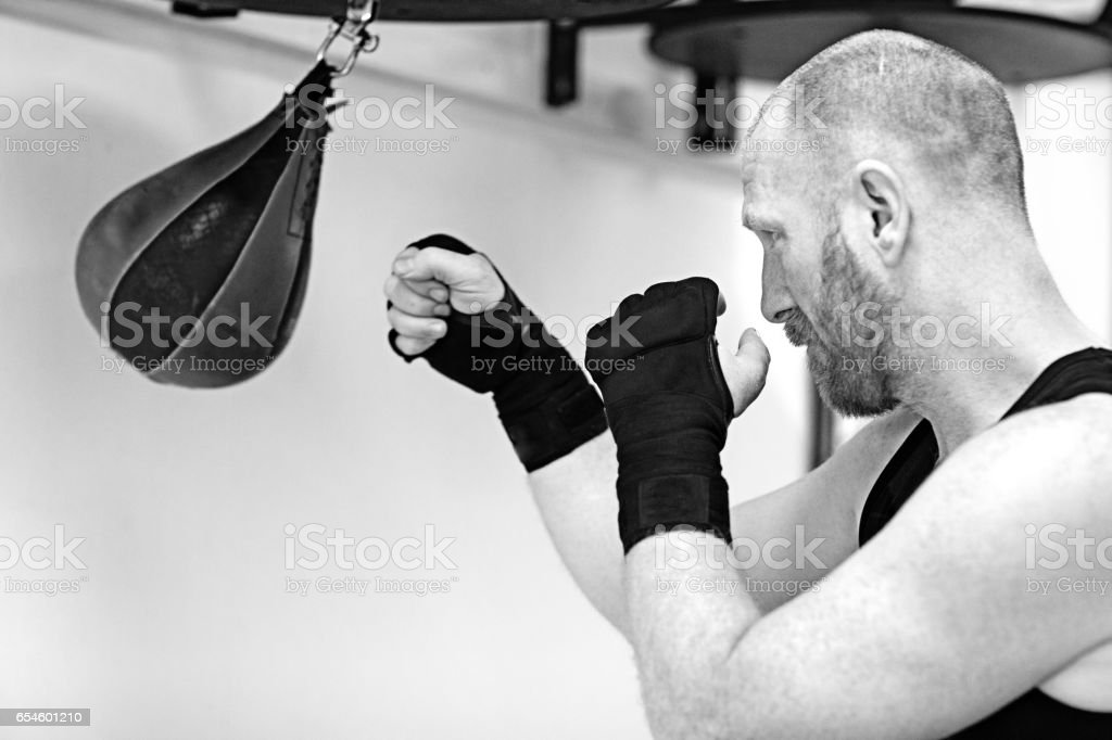 Middle Aged Man in Boxing Stance during a boxing workout in the gym stock photo