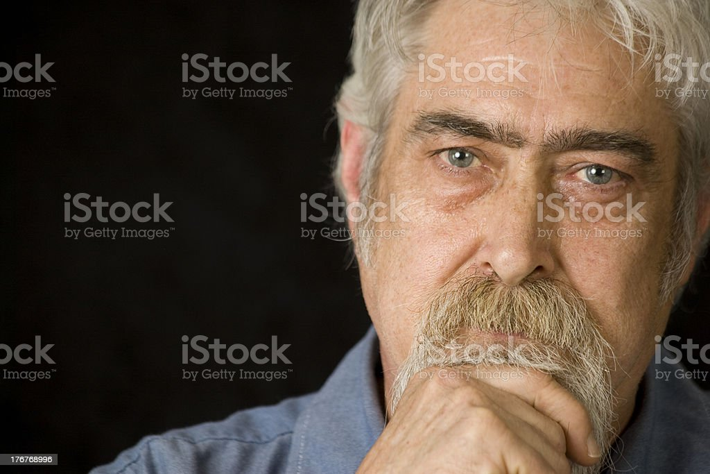 Middle Aged Man is Thinking royalty-free stock photo
