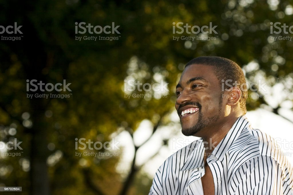 A middle aged man laughing outside royalty-free stock photo
