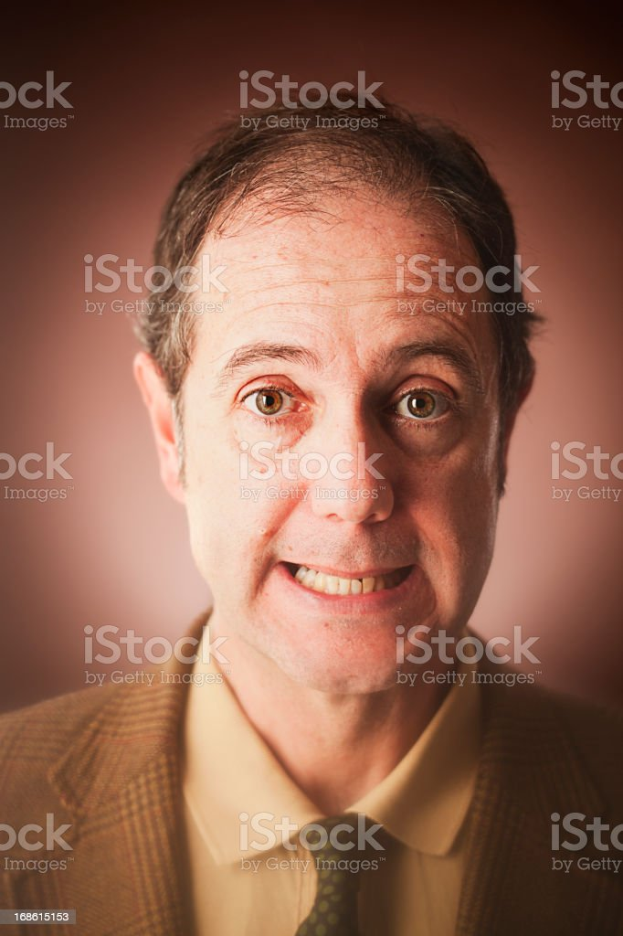 Middle aged man making funny face _ vertical royalty-free stock photo