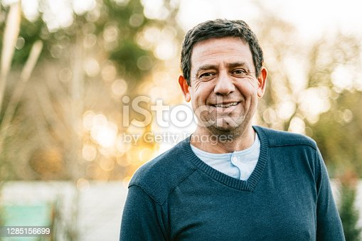 Middle aged man portrait at sunset