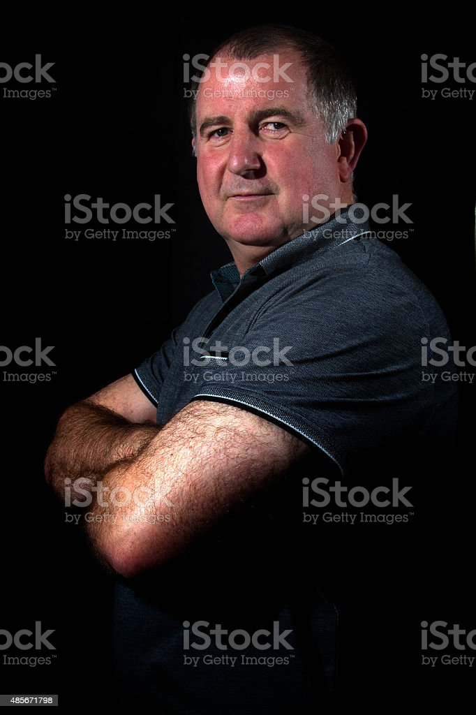 Middle aged man posing for the camera stock photo