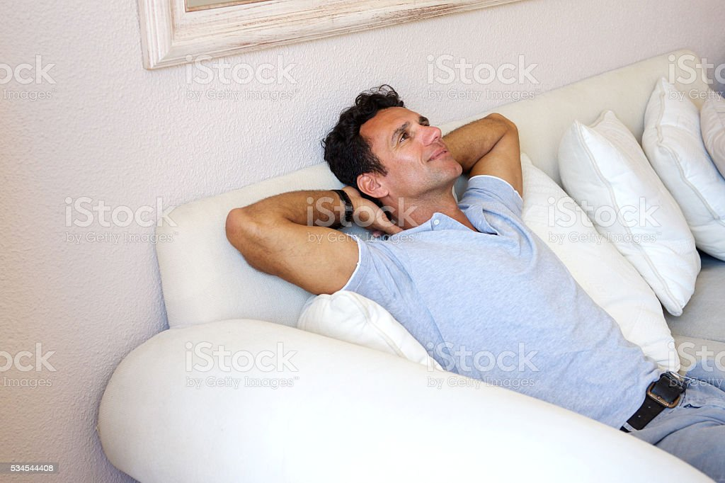 Middle aged man relaxing at home stock photo