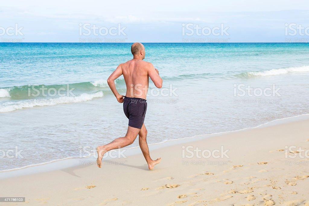 Mittleren Alter Mann läuft – Foto