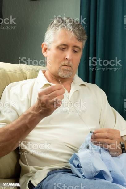 Middle aged man sewing button on shirt picture id959366998?b=1&k=6&m=959366998&s=612x612&h=x3qhv0puigfu6vj2gt4q2js c1kxgvbxdgfxareidug=