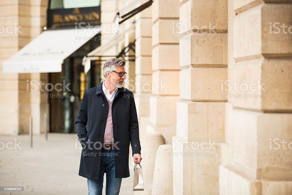 Middle aged man window shopping in Paris center. stock photo
