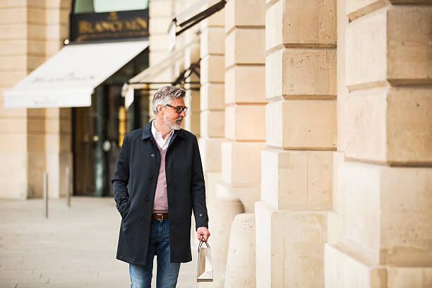 Middle aged man window shopping in Paris center. Middle aged man window shopping in Paris center. high society stock pictures, royalty-free photos & images