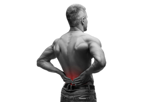 537234318 istock photo Middle aged man with back pain, muscular male body, isolated 610767846