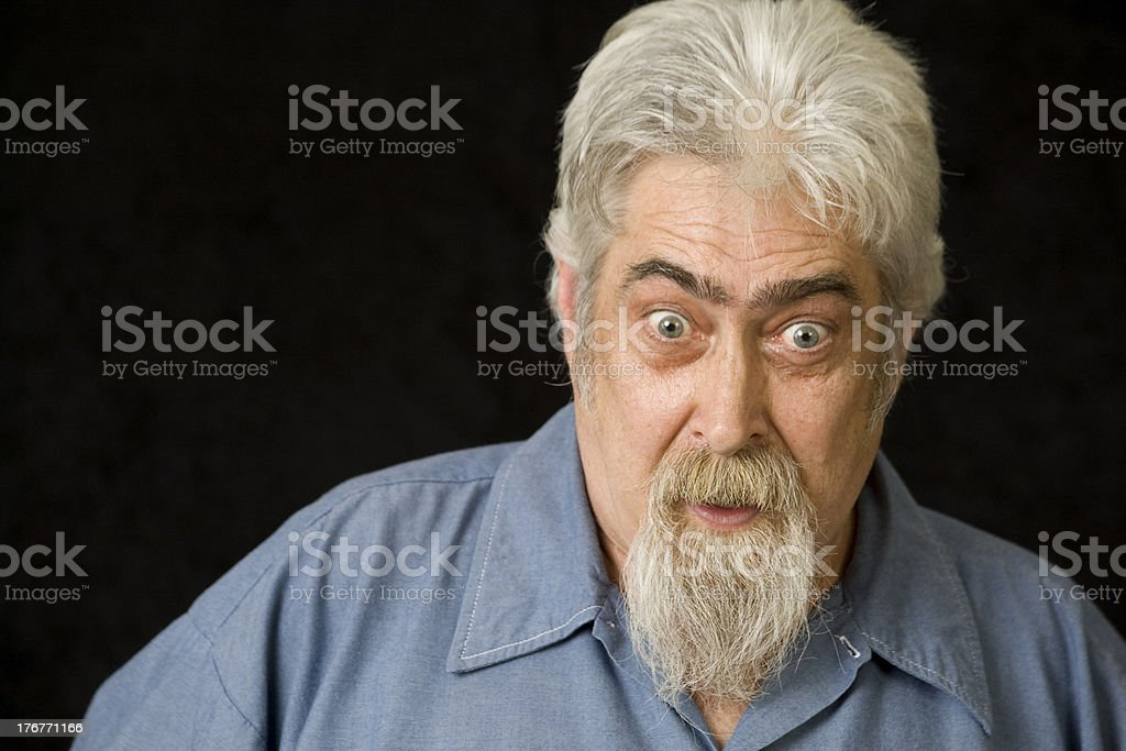Middle Aged Man with Beard is Surprised royalty-free stock photo