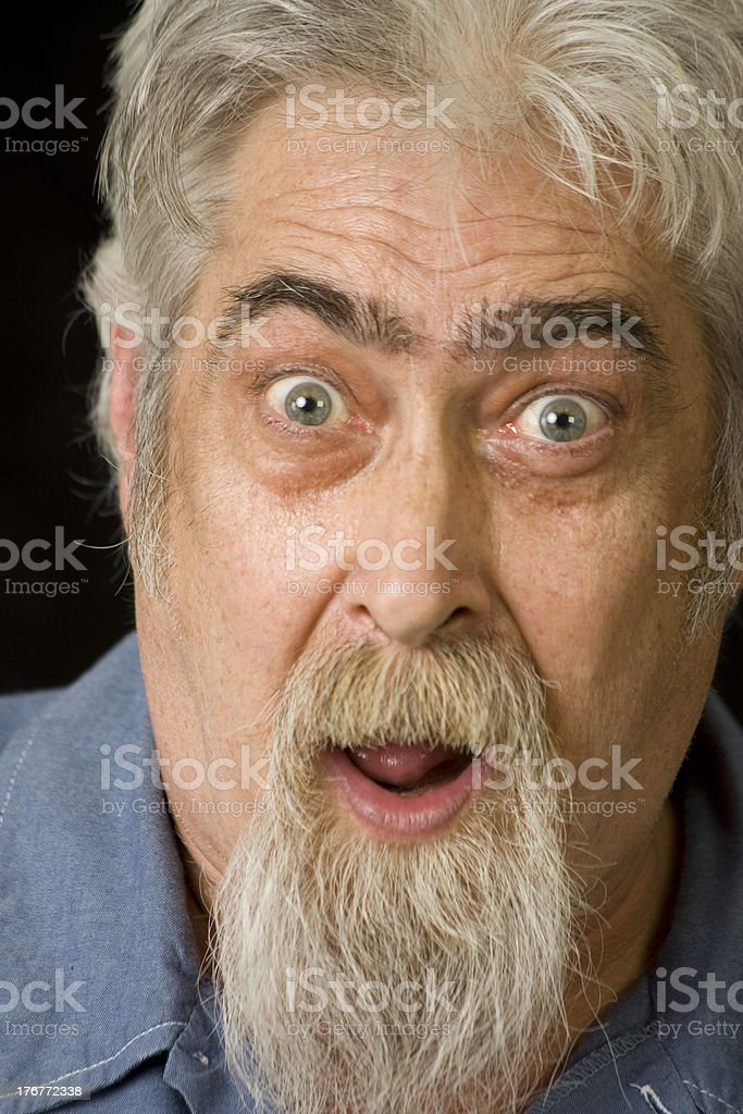 Middle Aged Man with Beard Looks Surprised royalty-free stock photo